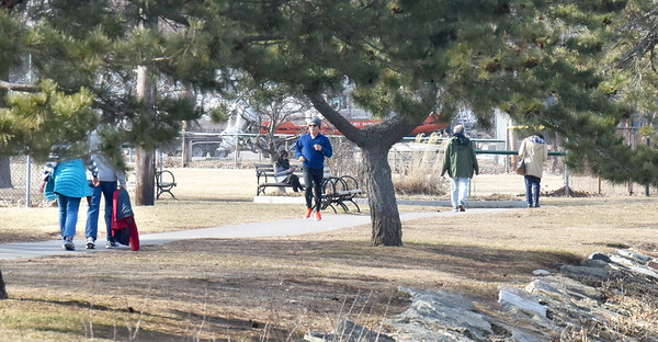 BRYAN EATON/Staff Photo. Runners and walkers took advantage of the 52 degree weather on the Harborwalk Rail Trail at Cashman Park in Newburyport. The temperature could approach 60 degrees today and stays a little above average for the rest of the week.