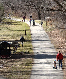 BRYAN EATON/Staff photo. Nice weather brought out people to the Clipper City Rail Trail late Friday morning in view looking south from the High Street railroad bridge.