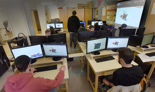 BRYAN EATON/Staff photo. Students construct 3-D Legos in the engineering lab at Amesbury High School on computers that were donated by an alum.