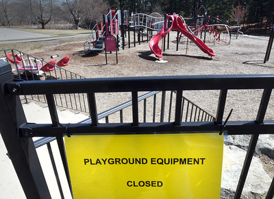 BRYAN EATON/Staff photo. Amesbury has followed Newburyport in closing its playground equipment, here at Amesbury Town Park. The nearby skateboard park had police tape blocking the entrances with similar signage as this.