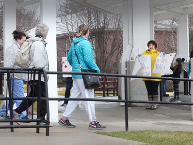 BRYAN EATON/Staff photo. Agnes Manning, at right, was one of about a dozen people, members of the Newburyport Book Club, greeting Anna Jaques Hospital nurses and staff thanking them for their work as they arrived for the second shift, or leaving the first, on Monday afternoon.