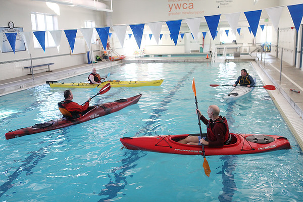Instructor Ken Taylor, left, talks to students during a Kayaking self-rescue class Sunday, March 1, 2020 at Newburyport YWCA. <br /> Photo By Nicole Goodhue Boyd