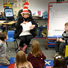 BRYAN EATON/Staff Photo. Amesbury School District curriculum secretary Carol Bartlett dresses as the Cat in the Hat as she and others from the community, including Mayor Kassandra Gove, read to students for Read Across America on Monday. The events are to get students excited about reading and falls on the day closest to Ted Geisel, a.k.a. Dr. Seuss' birthday although March 2 is the actual day.
