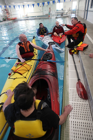 Ken Taylor gives rescue tips to Kerry Alvino, Andy Lintz, Ken Taylor, Pete Campbell, Mike Moloney, and Mike Cartisano during a Kayaking self-rescue class Sunday March 1, 2020 at Newburyport YWCA. <br /> <br /> Photo By Nicole Goodhue Boyd