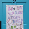 BRYAN EATON/Staff photo. Some residents in Newburyport's south end have been putting funny signs on their doors to give a little relief from the coravirus situation, here at 57 Milk Street.
