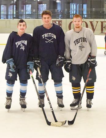 BRYAN EATON/Staff photo. Triton hockey players James Tatro, Brad Killion and Tyler Godfrey.