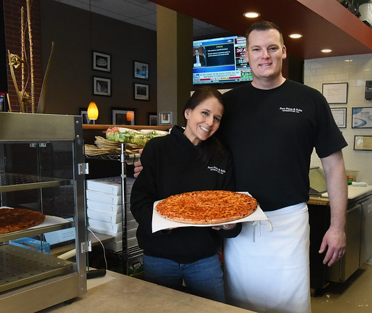 BRYAN EATON/Staff photo. Kelli and Robert Hartley of Port Pizza on Storey Avenue.