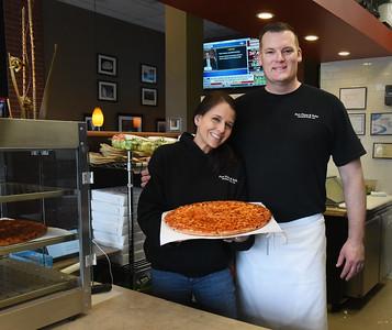 BRYAN EATON/Staff photo. Kelli and Robert Hartley of Port Pizza on Storey Avenue.