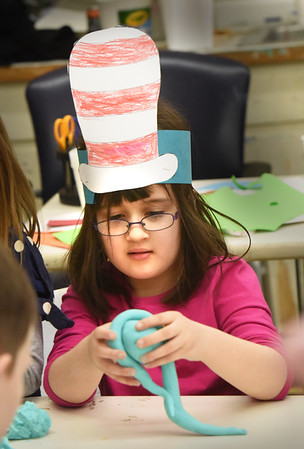 BRYAN EATON/Staff Photo. Lilah Dealmeida, 6, wore her Cat in the Hat creation she made at Salisbury Elementary School for Read Across America Week to the Boys and Girls Club. She was in art class where the youngsters were making different clay creations taught by art coordinator Coreen Peroraro.