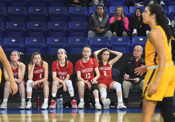 BRYAN EATON/Staff photo. Reality sets in on the Amesbury team as St. Mary's breaks away in the last minutes of the game.