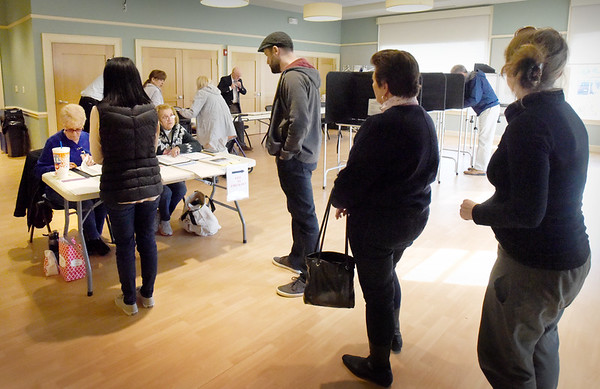 BRYAN EATON/Staff Photo. Voting was steady during the lunch hour at the Newburyport Senior and Community Center when Wards 5 and 6 residents cast their ballots.