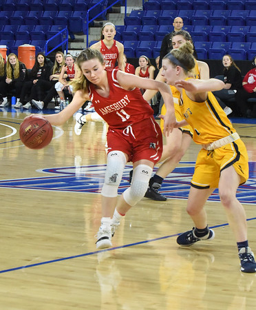 BRYAN EATON/Staff photo. Avery Hallinan moves around a St. Mary player.