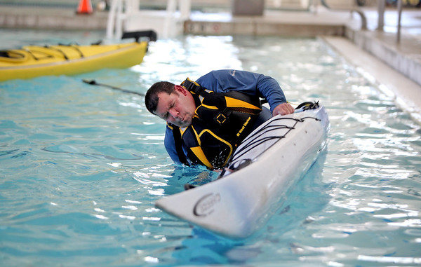 Pete Campbell of Atkinson, NH goes to roll for the first time during a Kayaking self-rescue class Sunday, March 1, 2020 at Newburyport YWCA. It was taught by Plum Island Kayak's Ken Taylor. <br /> <br /> Photo By Nicole Goodhue Boyd