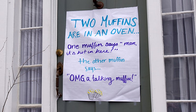 BRYAN EATON/Staff photo. Some residents in Newburyport's south end have been putting funny signs on their doors to give a little relief from the coravirus situation, here at 45 Bromfield Street.