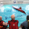 Ken Taylor talk to students about how to upright a kayak during a Kayaking self-rescue class Sunday March 1, 2020 at Newburyport YWCA. It was taught by Plum Island Kayak's Ken Taylor. <br /> <br /> Photo By Nicole Goodhue Boyd