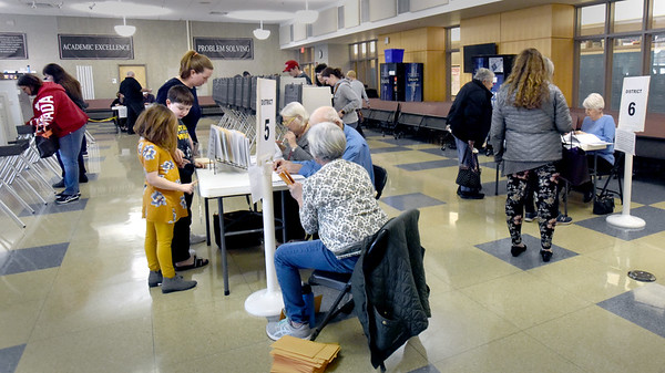 BRYAN EATON/Staff Photo.  A steady stream of voters were in Amesbury High School's cafeteria in mid-afternoon voting.