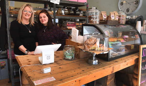 BRYAN EATON/Staff photo. Angry Donut co-owner Jill Passen, left, with daughter Olivia, closed the Winter Street, Newburyport shop at noon on Tuesday for an undetermined amount of time.