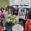 BRYAN EATON/ Staff Photo. The Boys and Girls Club hold their dinner and live and silent auction tomorrow, their largest fundraiser of the year. Showing off some items, from left, are members Damien Morales, 11, Trevor Souther, 14, and Lexi Locke, 11.