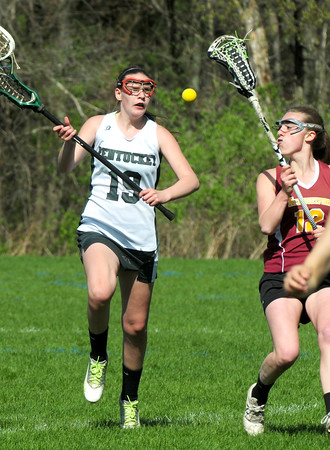 BRYAN EATON/ Staff Photo. Pentucket's 19 goes for the loose ball with Newburyport's Alexandra Peffer.