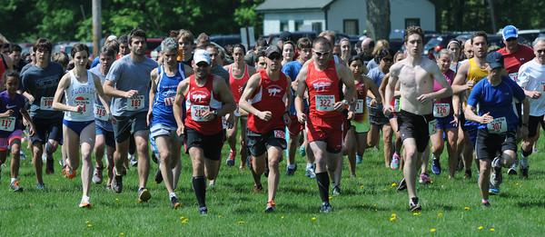 JIM VAIKNORAS/Staff photo  Runners take off at the start of  Trav's Trail Run at Maudslay State Park in Newburyport.