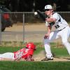 BRYAN EATON/Staff Photo. Pentucket first baseman Dan Beaton tries to pick of a Masco player.
