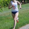 JIM VAIKNORAS/Staff photo <br /> Woman's winner Betsy Suda sprints to the finish at Trav's Trail Run at Maudslay State Park in Newburyport.