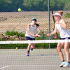 JIM VAIKNORAS/Staff photo Triton's double team Abby Booth and Abbey Killiam duringtheir match against Hamilton-Wenham at Triton friday.