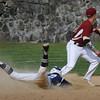 BRYAN EATON/Staff Photo. Triton's Tom Lapham eats the dirt on a double hit as Newburyport second baseman Brian Hadden waits for the throw.