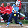 BRYAN EATON/Staff Photo. Triton's Zoe Cesati connects with the ball though she was forced out at first.