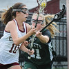 BRYAN EATON/Staff Photo. Manchester-Essex player Charlton puts the pressure on Newburyport's Margaret Cote.