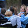 BRYAN EATON/Staff Photo. Members of the Triton High School girls junior varsity team bundled together against the cold wind as they watched the varsity team take on Ipswich on Thursday afternoon.