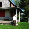 DYKE HENDRICKSON/Staff Photo. Bill Peterson of the Parker River National Wildlife Refuge next to the last private cottage on Plum Island which was owned by the Goodwin family and now will be razed.