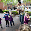 "BRYAN EATON/Staff Photo. With the weather Wednesday forecast to be nice the Newburyport Montessori School took their music classes outside. Teacher Neil Ferreira leads these youngsters to ""She'll Be Comin' Around the Mountains."""