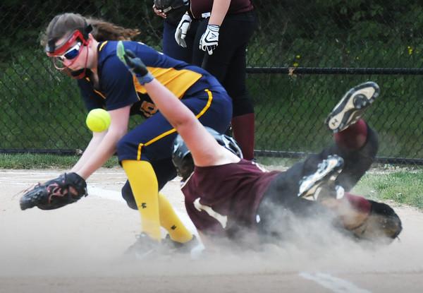 BRYAN EATON/Staff Photo. Newburyport's Stephanie Gleason got a little dusty on her safe steal of third base.