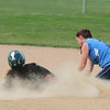 JIM VAIKNORAS/Staff photo Pentucket's Fiona Hill kick up a cloud of dust as she slides safely under the tag of Triton's Bridget Sheehan during their game at Triton Wednesday.