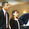ANGELJEAN CHIARDAMIDA/Staff Photo. Former Governor's Academy student Isaiah Wing stands yesterday at Newburyport District Court to hear the judge's ruling on charges he videotaped himself and his unsuspecting 16-year old classmate having sex while at school. With him are his attorneys Sharon Ray and Charles Rotundi.