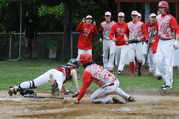 BRYAN EATON/Staff Photo. A double play for Newburyport fell short as Masconomet's # 2 makes it home as the Newburyport catcher scrambled for the ball.