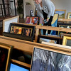 BRYAN EATON/Staff Photo. Karen Haas of the Museum of Fine Arts in Boston judges entries for the Regional Juried Show at the Newburyport Art Association.