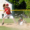 JIM VAIKNORAS/Staff photo Amesbury's Bradley Kelleher makes a play on Ipswich's Liam Sullivan at second base during their game at Amesbury Thursday.