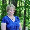 BRYAN EATON/Staff Photo. Getting acquainted with Raylene Kukene.