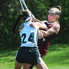 BRYAN EATON/Staff Photo. Pentucket's Liv Kemper (24) and Newburyport's Olivia Katavolos battle for the ball.