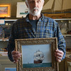 JIM VAIKNORAS/Staff photo Herb Crooker and his painting El Gallion at the Maritime Museum in Newburyport.