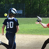 BRYAN EATON/Staff photo. First baseman Mikayla Porcaro is ready for the throw forcing Hamilton-Wenham's Abby Demers out.