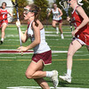 BRYAN EATON/Staff photo. Clipper's Olivia Katavolos runs down field.