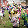 "BRYAN EATON/Staff photo. Students from the Newburyport Montessori School sing ""My Pretty Planet"" on Monday morning. The students were celebrating May Day with a parade through the downtown, then going to Brown Square for music and dancing around a Maypole."
