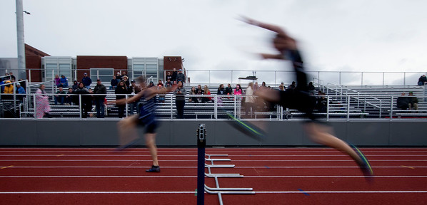 JIM VAIKNORAS/staff photo Runners compete in teh boys 400 meter hurtles at the Hernry Sheldon track meet at Triton Saturday.