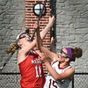 BRYAN EATON/Staff photo. Masconomet's Marrisa DeLucia and Newburyport's Cescily Wheeler jump for a loose ball.