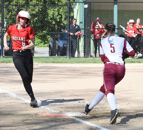BRYAN EATON/Staff photo. Newburyport first baseman Meghan Winn gets the throw to force Amesbury's Sage Dodier out.