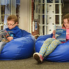 "BRYAN EATON/Staff photo. Reading on some cushy beanbags was a good place to be on a drizzly Tuesday morning in the library at Amesbury Elementary School. After story time youngsters got to check out some books and then started to read some of their choices. Cameron Hughes, 6, left, read ""A Boy Named Boomer"" and Olivia Scorzoni, 5, reads ""BRRR!"" about penguins, and polar bears and life in the Arctic."