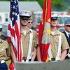 JIM VAIKNORAS/Staff photo Members of the USMC Jr ROTC stand at attention during the Memorial day Service at Seabrook Square Sunday morning.